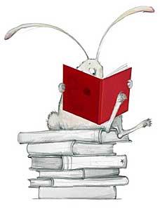 Nyuszi ül a nyereménykönyveden és már olvassa! :-)